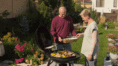 photo of two people grilling vegetables
